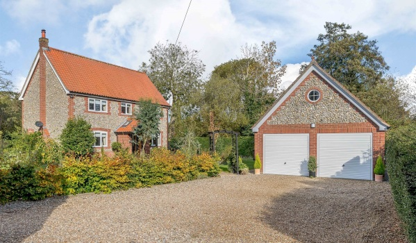 A detached home with a double garage and annex in Thetford