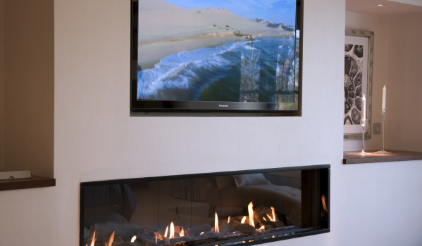 TV above fireplace.