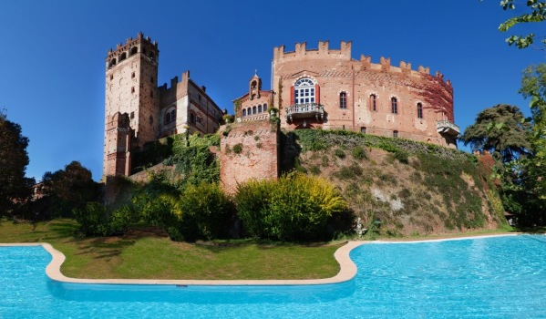 An 11th century Italian castle high on a hilltop with a swimming pool
