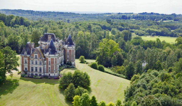 Aerial picture of fairy tale-like French castle with sweeping lawns and woodlands
