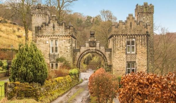 Castellated gate house nestled in a West Yorkshire valley