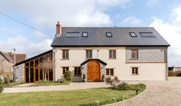 A renovated house with a new extension and loft conversion.