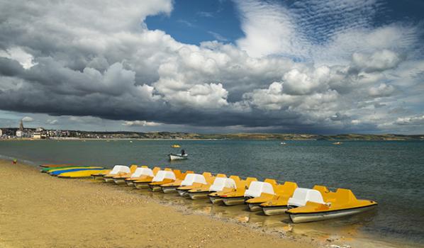 pedalos on a Dorset beach