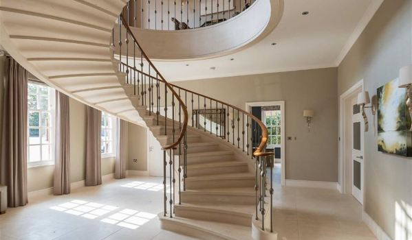 Luxury limestone staircase with metal spindles