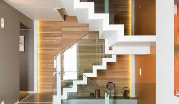 Floating white concrete and glass staircase