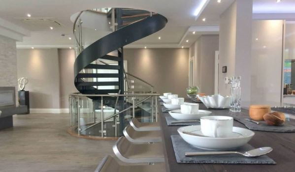 Steel spiral staircase with aluminium handrail