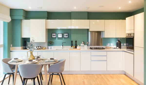 A modern kitchen with white glossy units