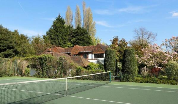 Tennis court in the garden of cottage-like home in London