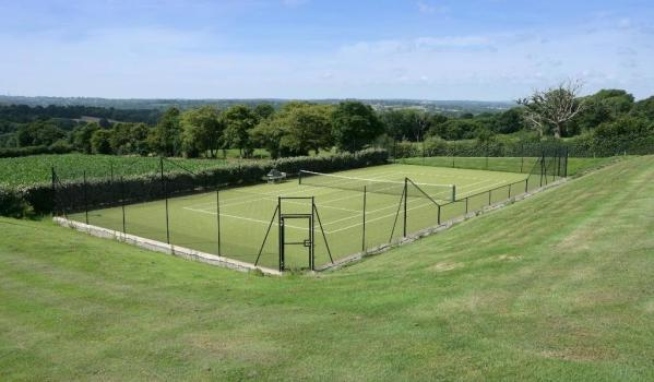 Tennis court with stunning views of the Kent countryside as a backdrop