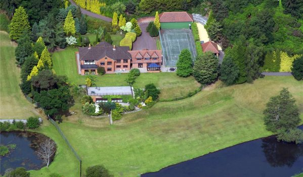 Aerial view of Hampshire mansion with tennis court