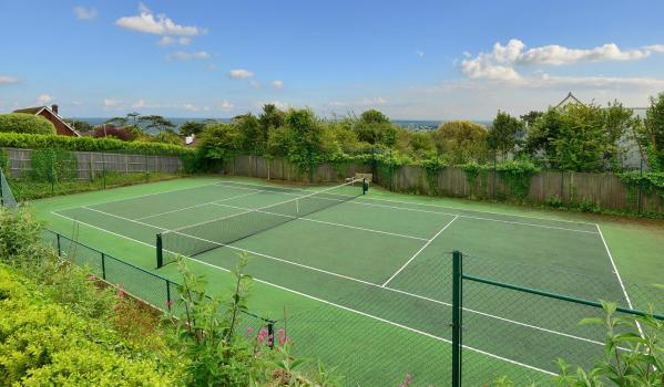 Pristine tennis court with views of the sea