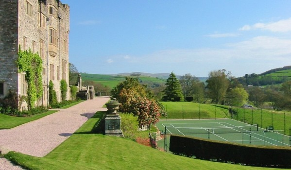 Tennis court in the grounds of a Grade I listed mansion in Devon