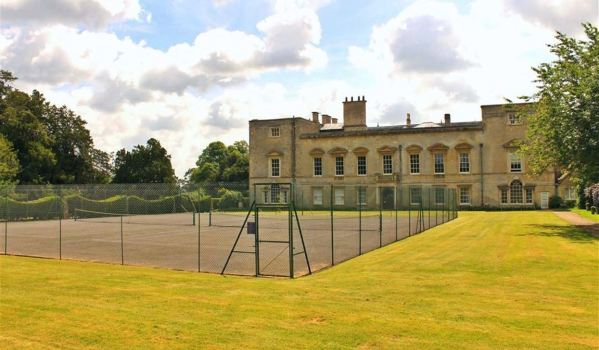 Two tennis courts in the grounds of an Elizabethan manor in Buckinghamshire