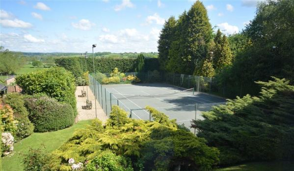 Private tennis court with floodlights in Derbyshire