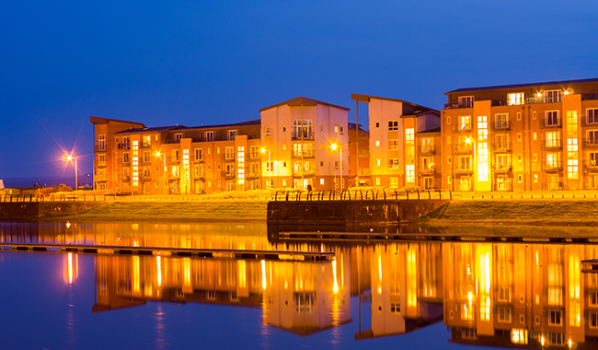 Waterfront apartments in Llanelli at night