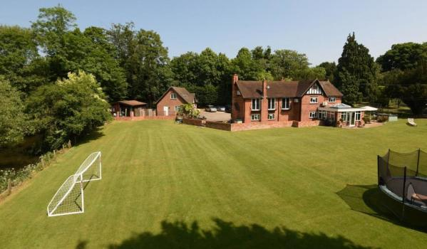 Detached house backing on to the River Loddon