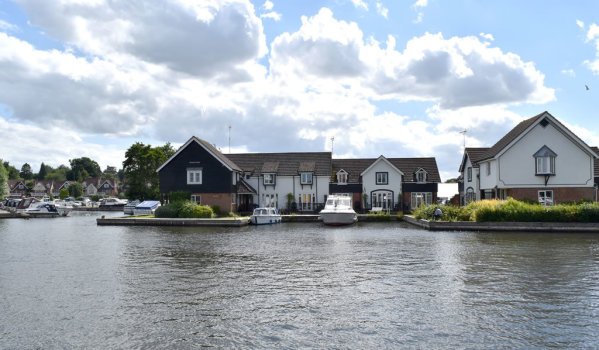 A townhouse with its own mooring instead of a driveway