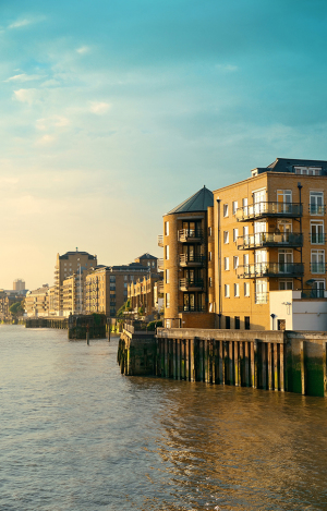 Waterfront apartments in East London at sunset