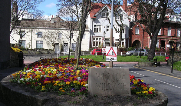 Period buildings and a flower bed in Westoe Village