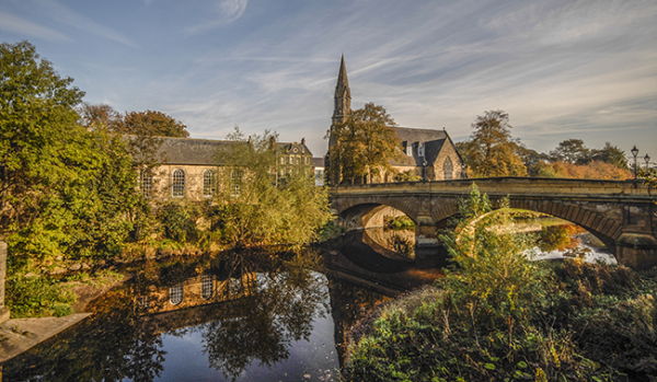 A church and bridge in Morpeth by the River Wansbeck