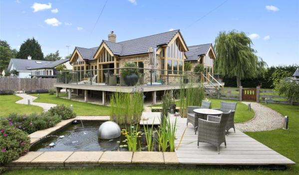 The landscaped gardens of a riverfront house in Shepperton
