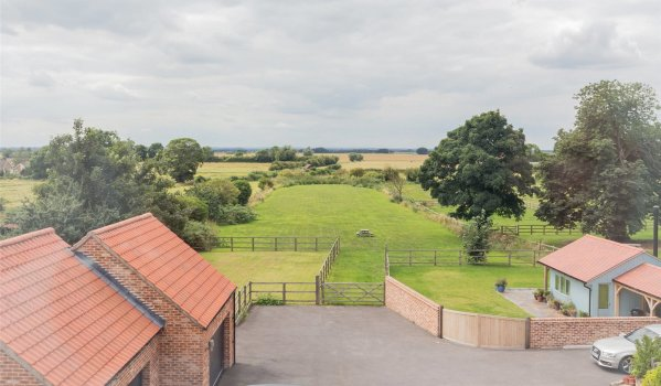 Views of the countryside from the window of a detached house in Misterton