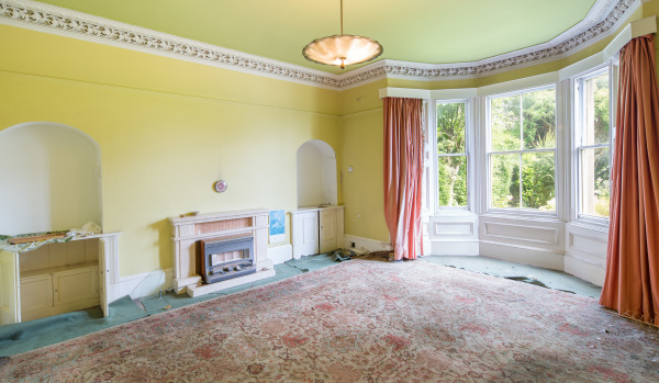 A reception room in need of redecoration in Victorian house in Wemyssfield