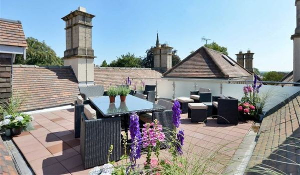 An elegant roof terrace on top of a manor house
