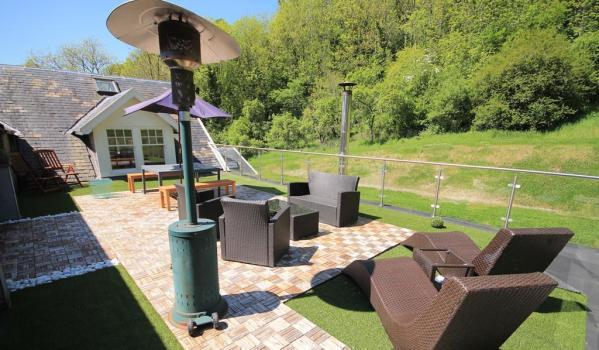 Large roof terrace with furniture and a patio heater in Crossford