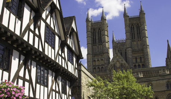 Lincoln cathedral and an old Tudor building