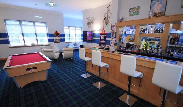 Games room and bar inside a six-bedroom detached house in Bothwell
