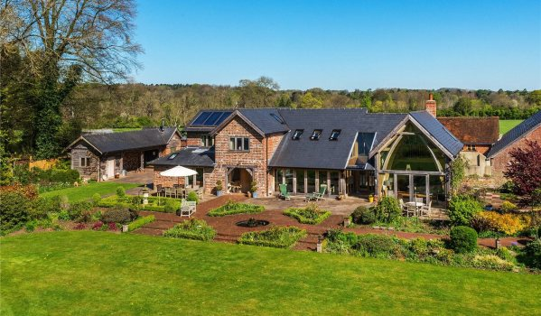 Two cottages transformed into one six-bedroom home in Alton