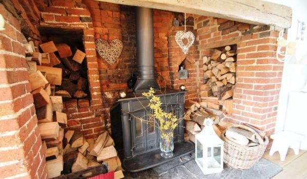 Inglenook fireplace in a traditional cottage