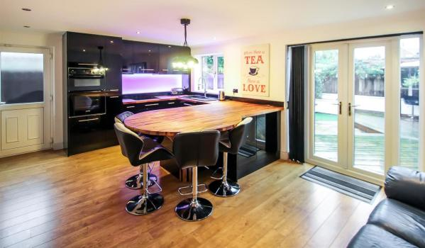 Glossy black kitchen in a family home in Arnold