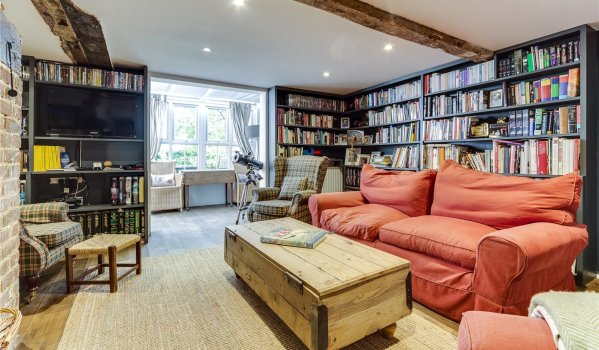Snug filled with books in a house in Danehill
