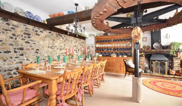 Charming dining room of a converted cow barn in Martin