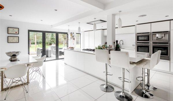 Chic white kitchen in Pirbright