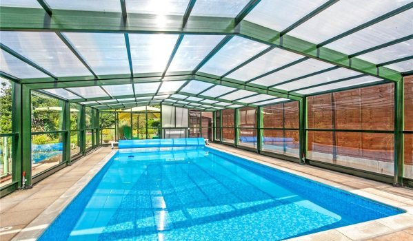 Swimming pool with retractable roof in Old Bishopstoke