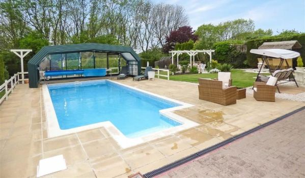 Outdoor Swimming Pool With Retractable Roof In Great Hay