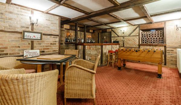 Basement bar and games room in a Georgian house