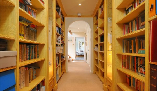 Hallway library in a six-bedroom detached house in Hampton