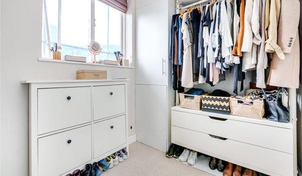 Walk-in wardrobe in a one-bedroom flat in Maida Hill