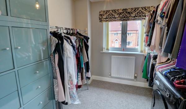 Walk in wardrobe in a four-bedroom semi-detached house in Middle Littleton