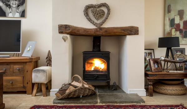 Proving Not All Fireplaces Have To Be Mive Make An Impact The Modern Wood Burner In This Inviting Family Home Adds A Huge Amount Of Character