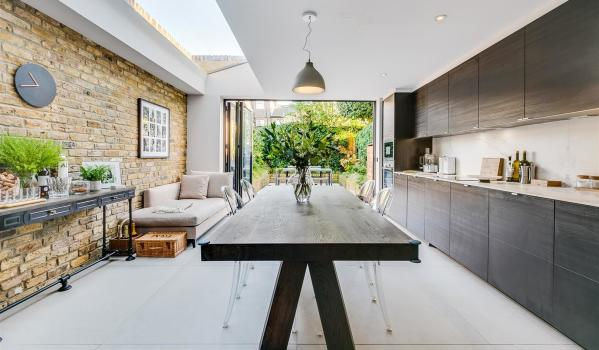 A modern kitchen extension with skylight and bi-fold doors