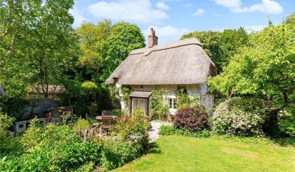 English country cottage with thatched roof