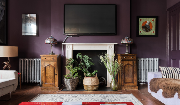 A cosy living room with striking purple walls