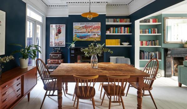 Stylish dining room with bold dark walls