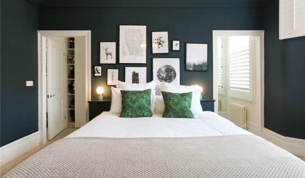 Treny bedroom with dark walls