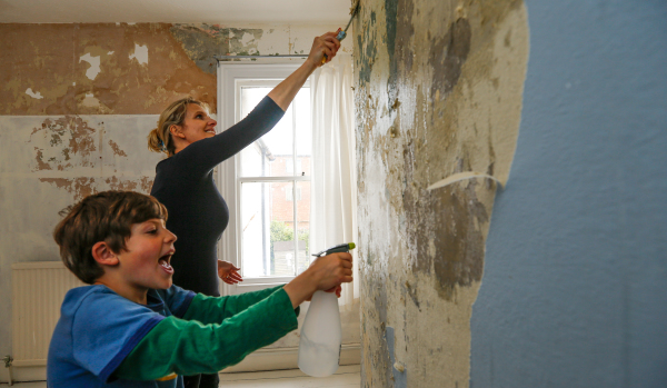 Mother and son decorating new home